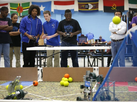 Students from Godby, Rickards and SAIL high schools compete in a robotics competition at Rickards earlier this month.