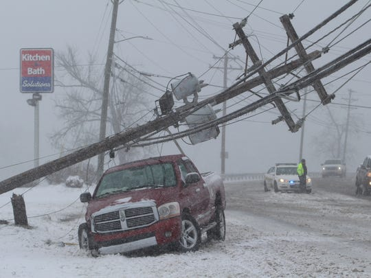 A truck collided with a power pole on Riverside Drive
