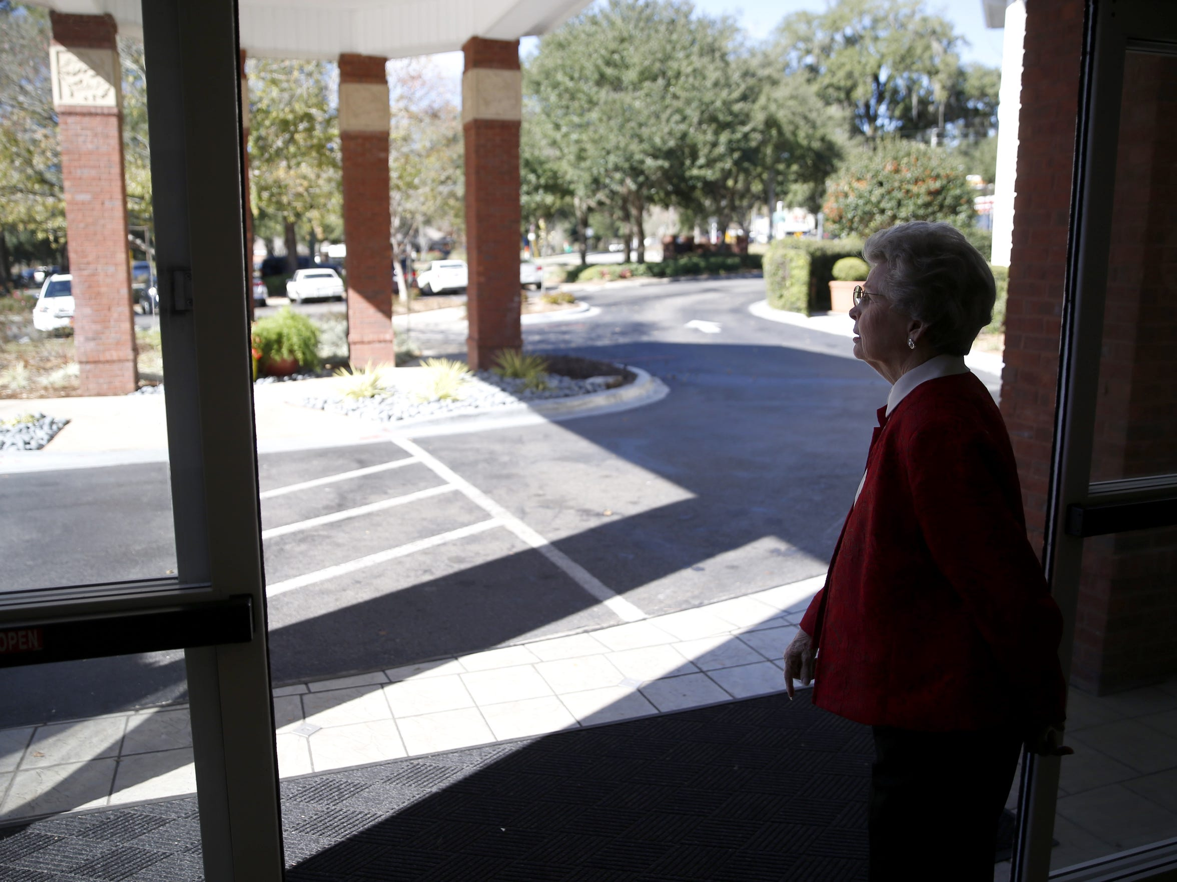 Betty Sue Jones Jackson, a resident of Allegro, looks out the front door of thesenior living facility on Friday, Jan. 15, 2016.