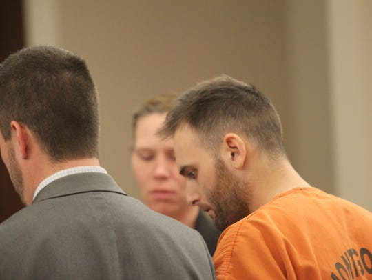 Kyle Thomas Heade, right, and his attorney, Eric Yow,