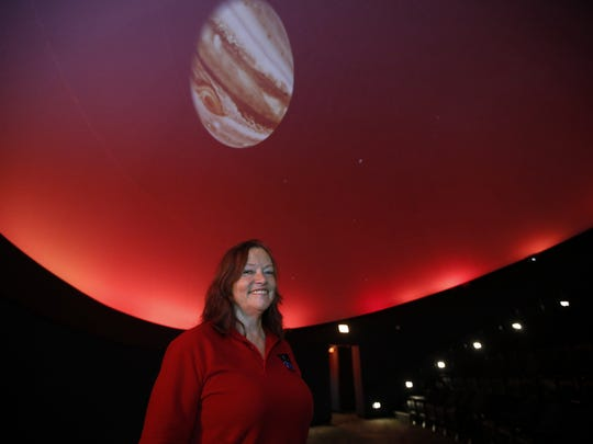 Challenger Learning Center Education Manager Susan Borland stands in the planetarium, one of the space exploration learning stations for children at the downtown center.