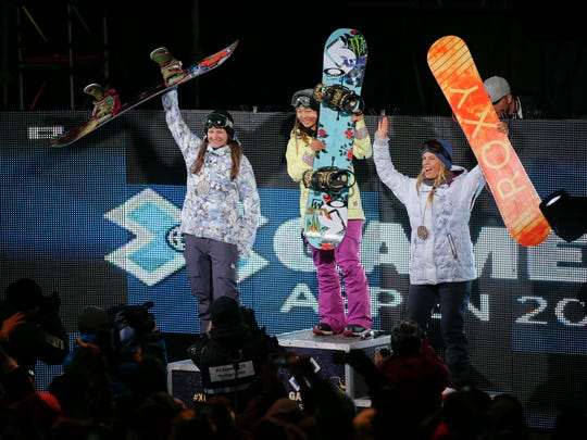 Chloe Kim (center), Kelly Clark (left) and Torah Bright take the stage during the Winter X Games on Jan. 24, 2015 in Aspen.