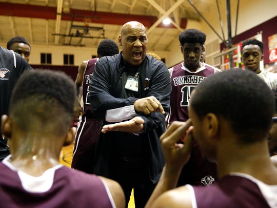 West Gadsden Head Coach Andrew Moten talks to his team from a huddle during a timeout in their game against Florida High on Friday.