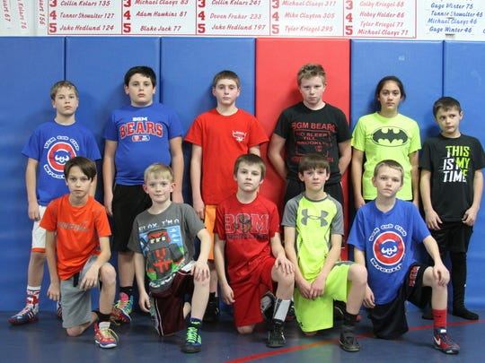 These wrestlers qualified for the AAU District meet to be held on Feb. 7. They include, front row from left, Brayden Hepke, Preston Mann, Shamus Keller, Dallon Murty and Sawyer Callahan. Back row, Cooper Winter, LJ Henkle, Ryan Hopwood, Connor Cooling, Jessica Haines and Clayton McKee. Not pictured, Mason Maschmann, Dominic Coleman and Briar Kriegel.