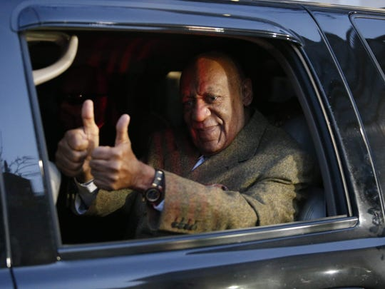 Bill Cosby gives double thumbs up as he leaves courthouse