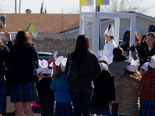 A mini pope was paraded around St. Raphael Catholic