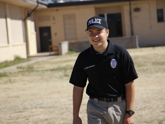 A police officer officiates at the Hornet's Super Bowl Saturday Family Event.