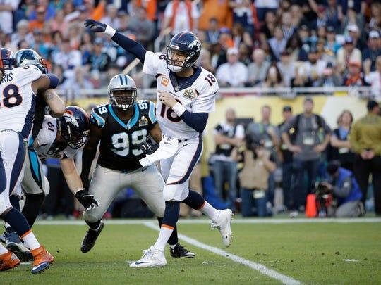 Denver Broncos' Peyton Manning (18) passes against Carolina Panthers during the first half of the NFL Super Bowl 50 football game Sunday, Feb. 7, 2016, in Santa Clara, Calif. (AP Photo/Marcio Jose Sanchez)