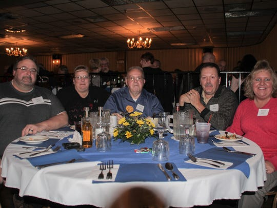 Larry Miley Sr., center, is pictured at his table at
