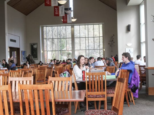 Students and visitors eat lunch in one of the dining spaces at Goudy Commons.
