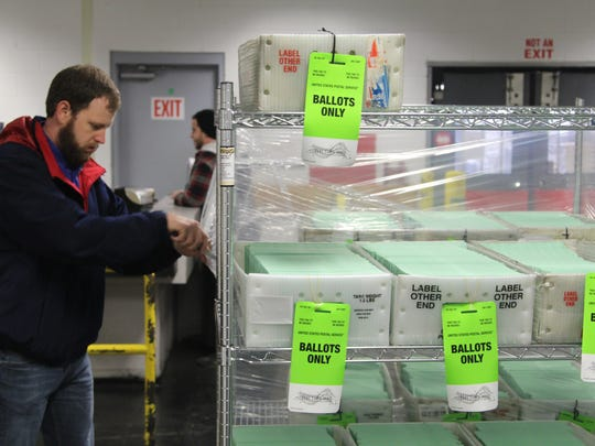 Ballots are unwrapped at the U.S. Post Office in Tallahassee to be mailed out to Leon County voters.