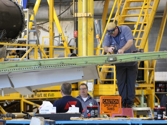 ExpressJet employees stopped working to listen to Thursday's announcement of a facility  expansion in Shreveport.
