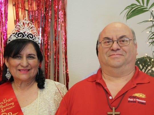 Queen Alicia Escalera, left, and Emilio Arce