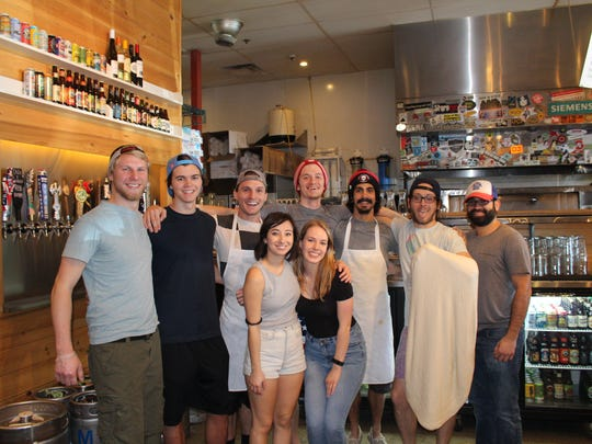 Lazy Moon employees pose for a group shot in the bar