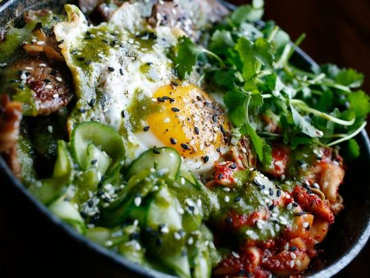 The bulgogi rice bowl with fried egg, Kimchi, pickles,