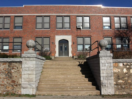 The Springfield school board agreed to sell the former Bailey school at 501 W. Central St. to a local developer.