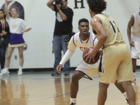 Clarksville High's J.J. Jones guards Kenwood's Matthew Norl in a district game earlier this season. Both teams will host quarterfinal games Friday night.