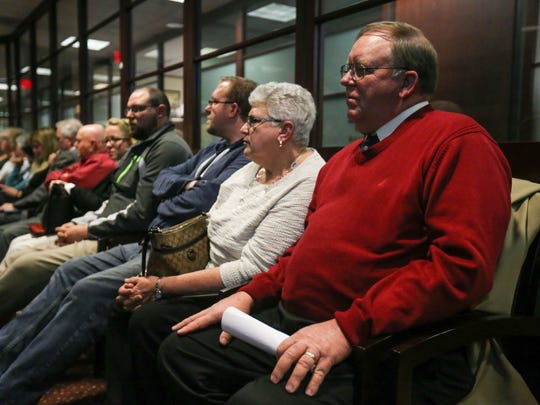 Observers watch the New Castle County Council meeting on Tuesday in Wilmington, where members discussed the potential purchase of two farms. Members spent hours talking about the proposal.