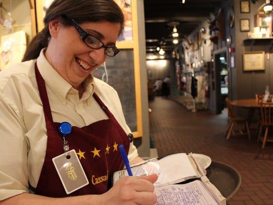 Cassandra Kelly takes a to-go order at Cracker Barrel