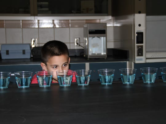 A student from North Elementary learns about the Earth's water through a visual aid at the Brackish Groundwater National Desalination Research Facility on Friday.