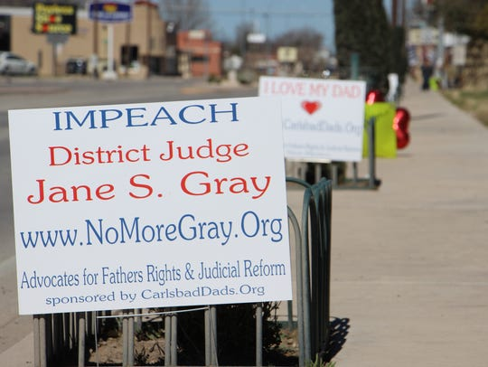 Signs from a rally outside of Eddy County Courthouse.