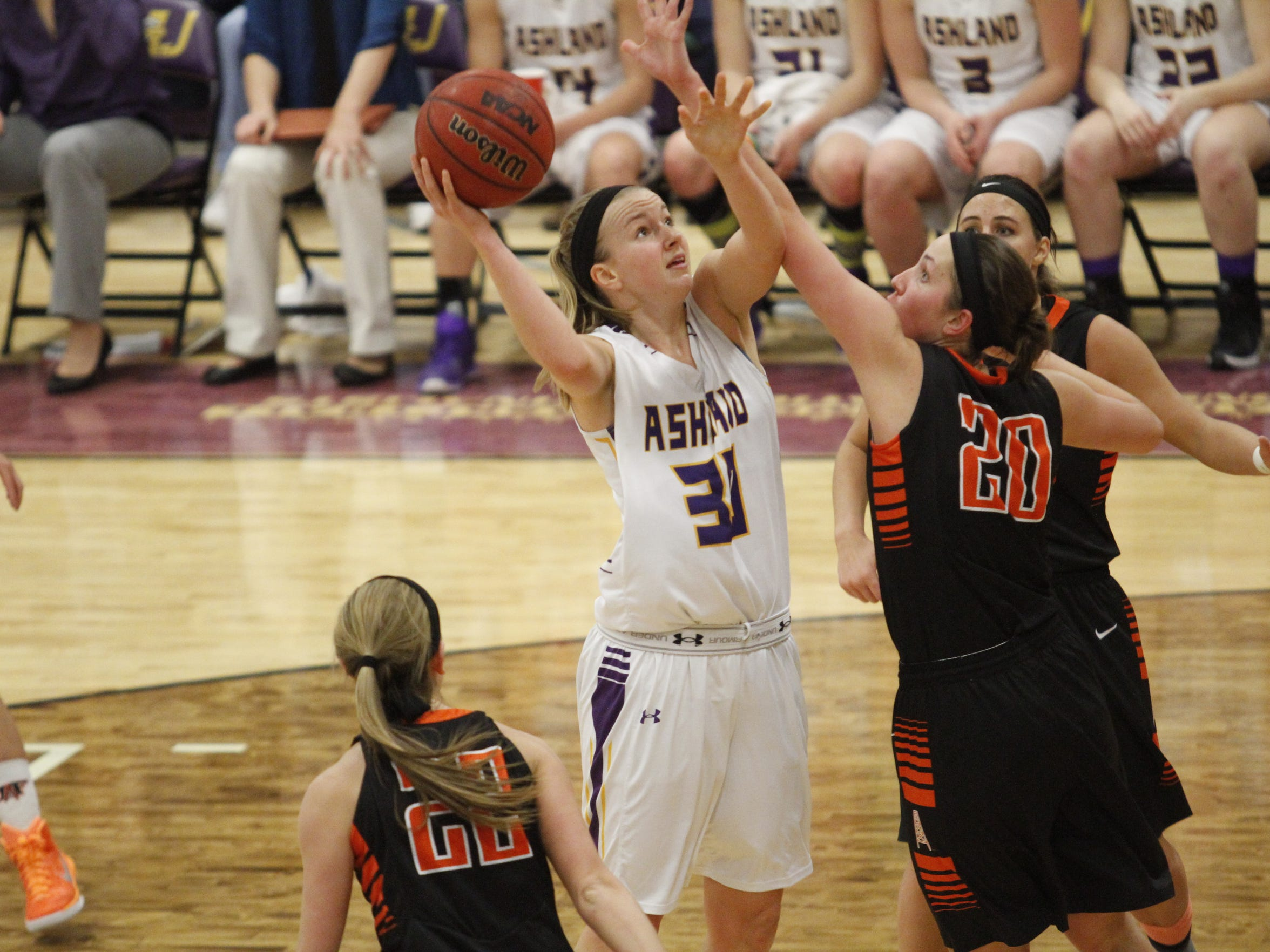 Andi Daugherty attempts a shot against the University of Findlay during a college women's basketball game on Thursday, Jan. 22, 2015