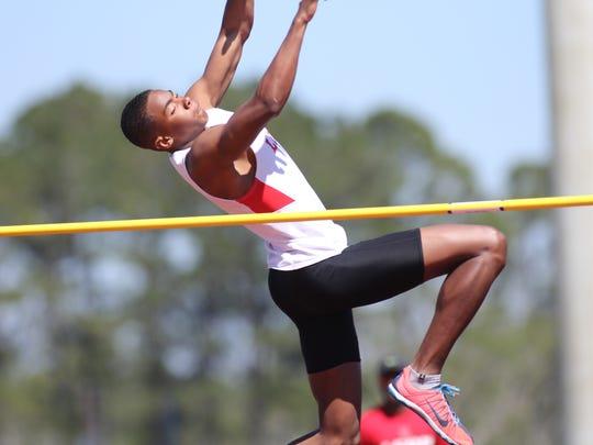 Leon senior Stanley Davis clears the high jump bar