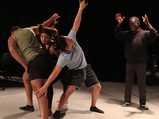 Luther Cox, Jr., director of Inter City Row Modern Dance Company, teaches dancers choreography for AS IS performance.