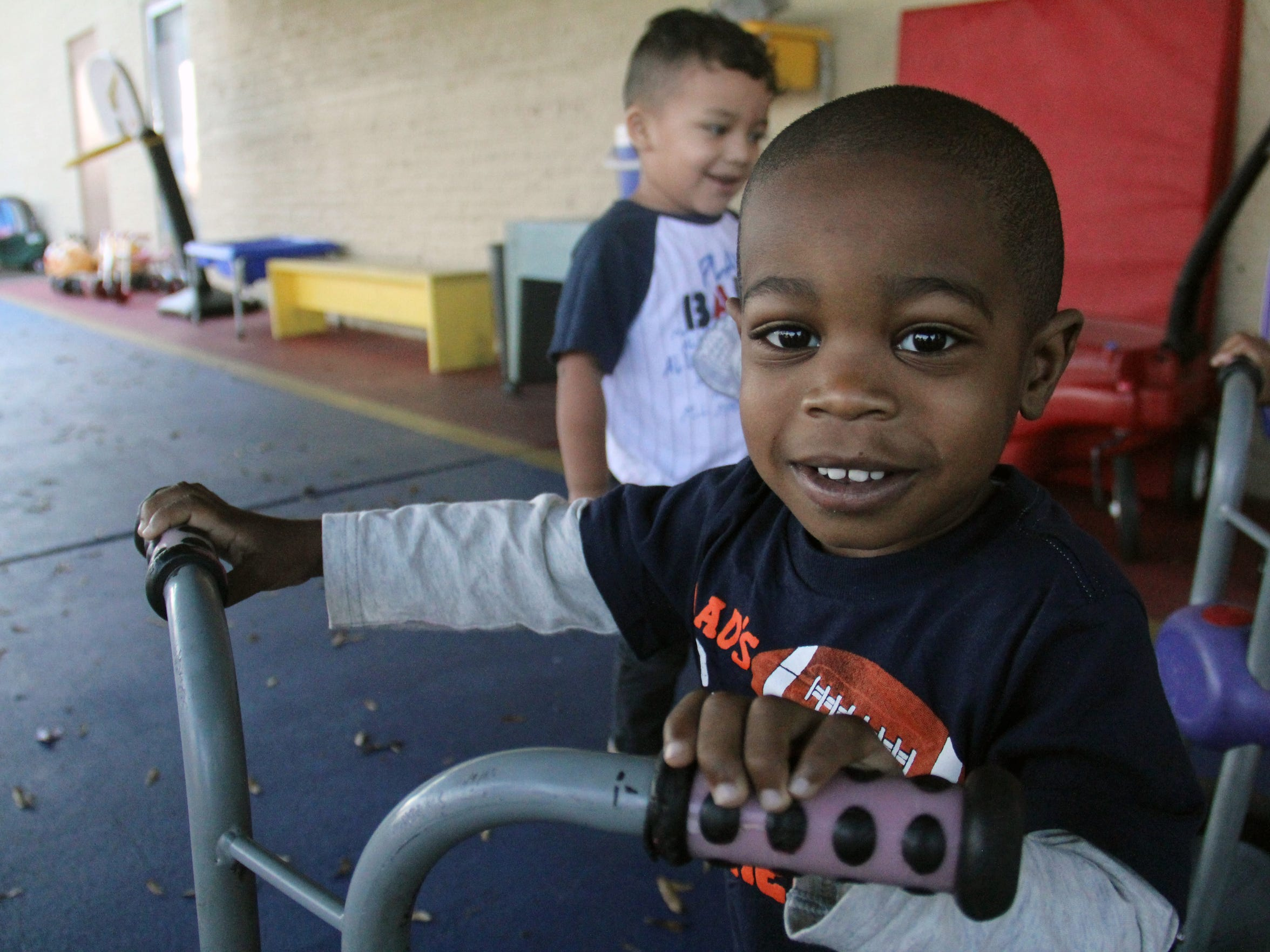 A child rides a bike on the playground at Global Connections Learning Center in Jackson.