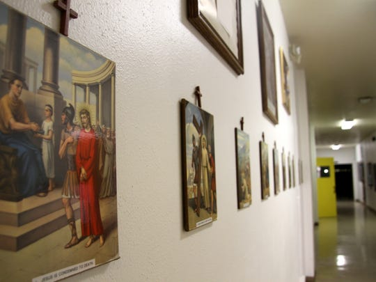 The Stations of the Cross are seen in a hallway in
