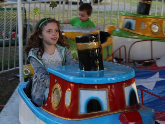 Mylie Schmidt enjoys a carousel-type ride.