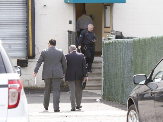 Federal agents enter 29 Robert Pitt Drive in Spring
