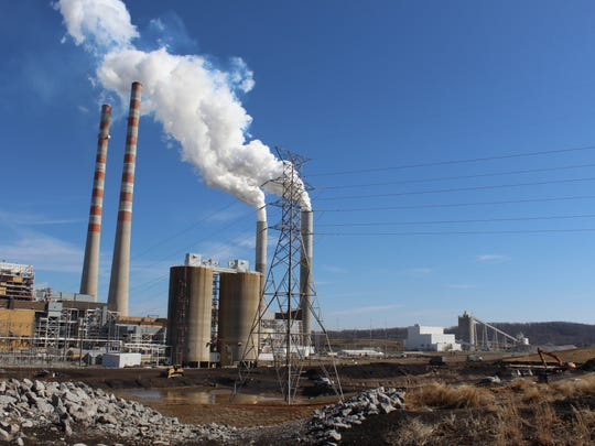 """A view of the Cumberland Fossil Plant shows the iconic 600-foot smoke stacks that are no longer used and the smaller stacks that release mostly steam after a """"scrubbing process."""" The two silos hold dry coal ash to be loaded into trucks and sold for use in concrete."""