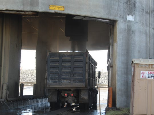 Dry coal ash is loaded into a dump truck at Cumberland