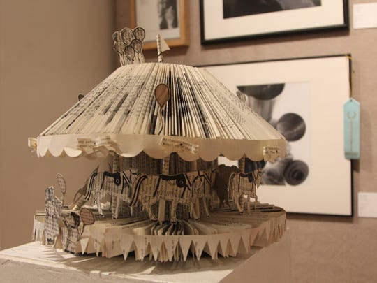 """Carousel,"" made of a discarded book, created by Lincoln High School senior Odytte Chuy"