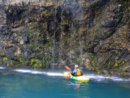 """Peter Gandesbery paddles into the """"Grotto"""" on the North Fork of the Smith River."""