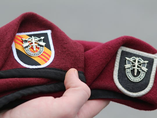 At left is 5th Special Forces Group's Vietnam-era beret