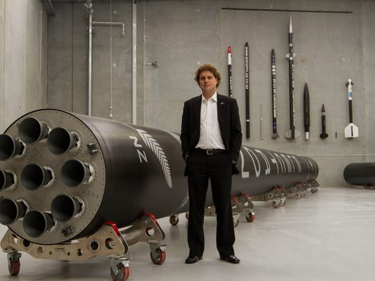 Rocket Lab CEO Peter Beck with an Electron rocket.