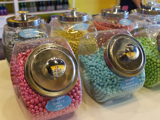 Popcorn, candy and specialty sodas are sold at Sugarwalk