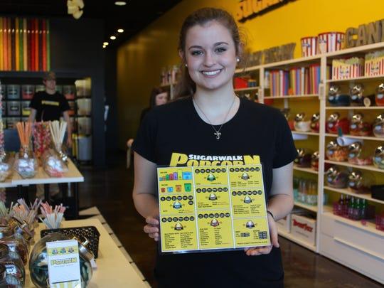 Greeter Megan Richardson, 16, welcomes guests at Sugarwalk