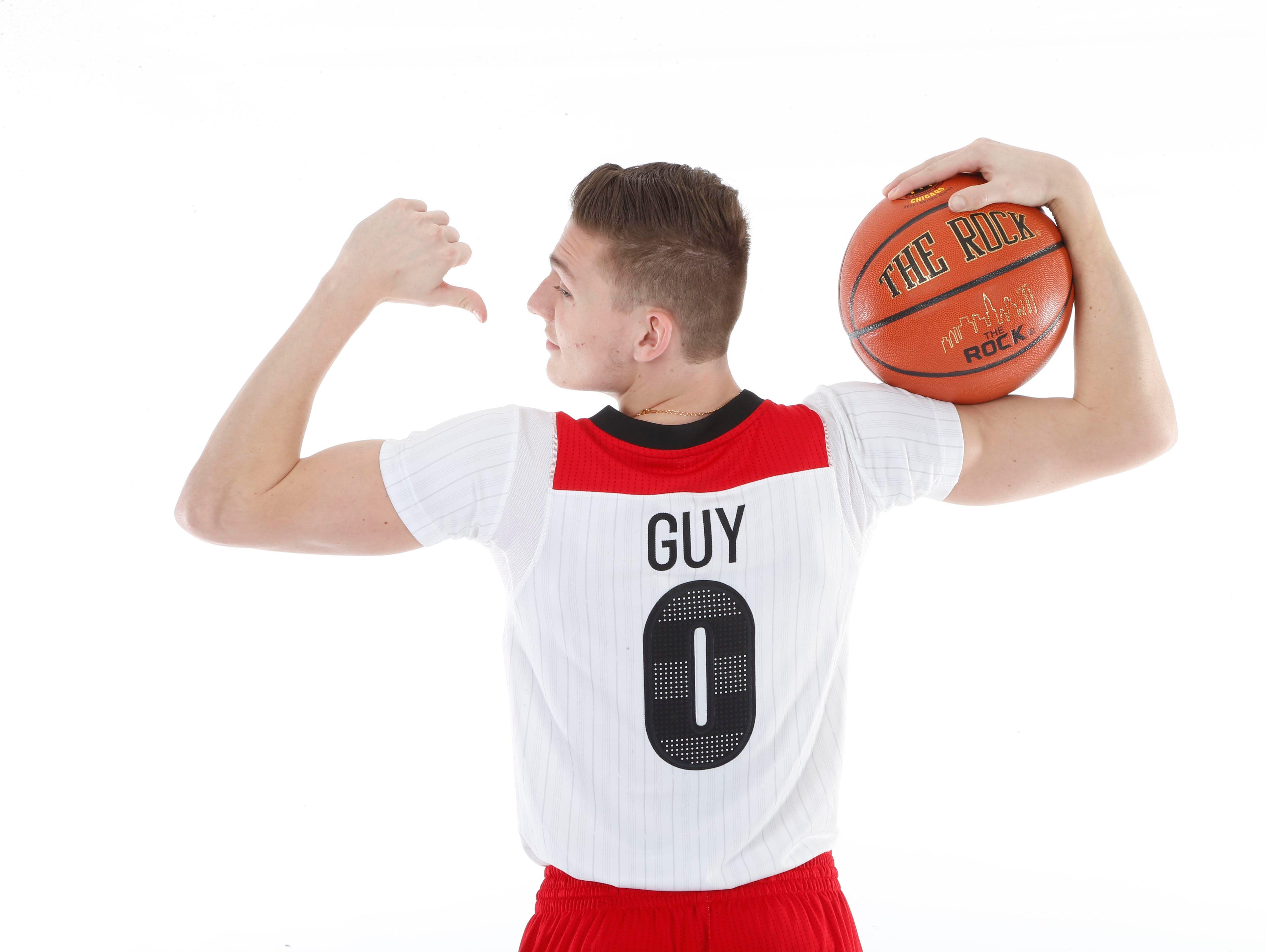 McDonalds All American guard Kyle Guy (0) poses for photos on portrait day at the Marriott Hotel.