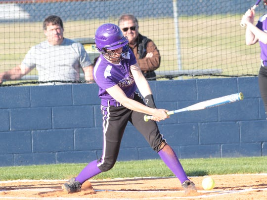 Clarksville High takes a swing at a pitch during the