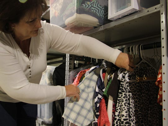 Majorie Gregory, the secretary treasurer of Faith, Hope, and Love Foundation, looks at donations at their new building.