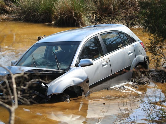 Crews worked to tow a car out of a rural pond Tuesday
