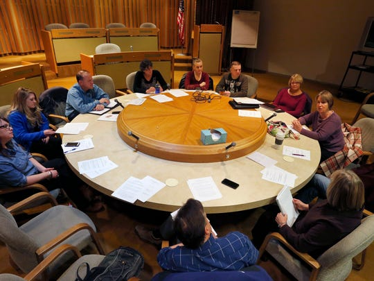 In this Feb. 23, 2016 photo, members of local government and non-profits talk during the monthly suicide prevention meeting, in Montrose Colo, where suicide rates are among the highest in the nation. Across the U.S., suicides account for nearly two-thirds of all gun deaths, with 21,334 gun deaths by suicide in 2014, according to federal data. (AP Photo/Brennan Linsley)