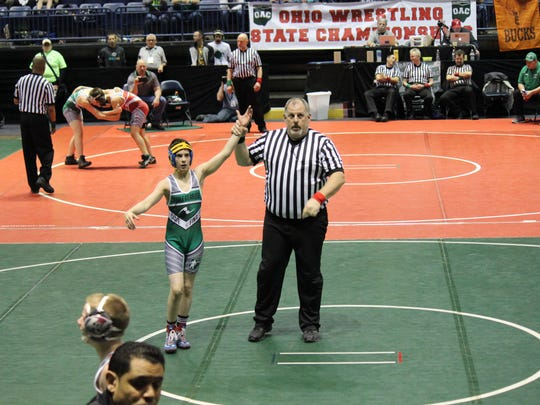 Landon Campbell of Ontario has his hand raised after winning an Ohio Athletic Committee state wrestling title in Youngstown.