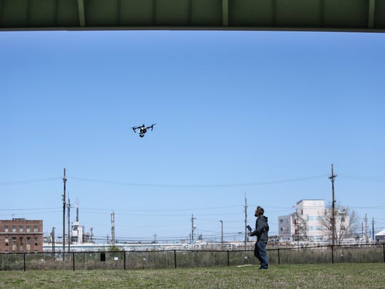 Keystone Aerial Surveys unmanned aerial systems pilot Dan Payn flies a  drone to take photos and video of the Delaware Memorial Bridge. DRBA officials said the drones will make bridge inspections faster, more efficient, and safer