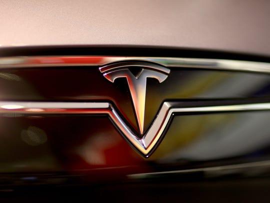 A Tesla Motors vehicle is seen on the showroom floor