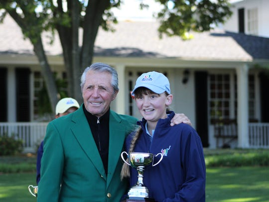 Nicole Adam was presented her third-place trophy in the Drive, Chip and Putt national finals by golf legend Gary Player.