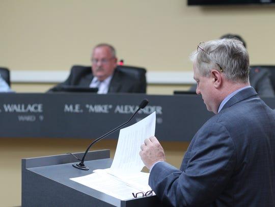 Clarksville city attorney Lance Baker, right, explains